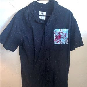 On the byas button up t-shirt.